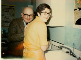 "Carel and Bill Germain ""in the kitchen-- where else?...our home on Beacon St., Boston,"" 1969"