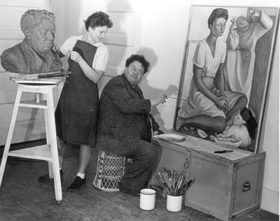 Frances Rich working on a bust of  Diego Rivera while Rivera works on a painting of Frances Rich, 1941