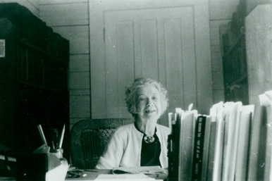 Mary Ritter Beard at her desk, Christmas, 1954