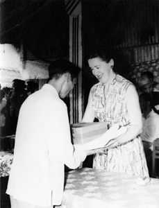 Helen Begley Nixon distributing care packages to Vietnamese refugees, circa 1960s