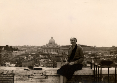 Gladys Swackhammer on parapet of Castil Gandalpho (with St. Peter's basilica in the background), Rome, 1932