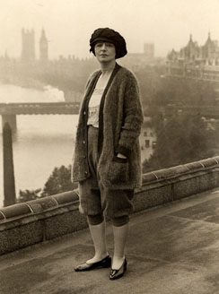 Jane Burr atop the Savoy Hotel with Houses of Parliament in distance, London, 1922