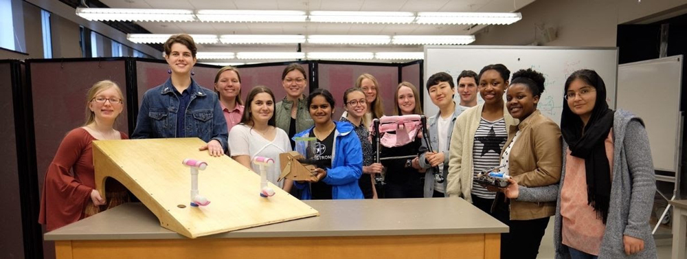 Students with the assistive devices they created
