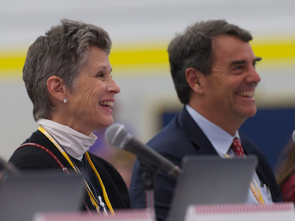 Melisa Parker and Tim Draper smiling during a presentation