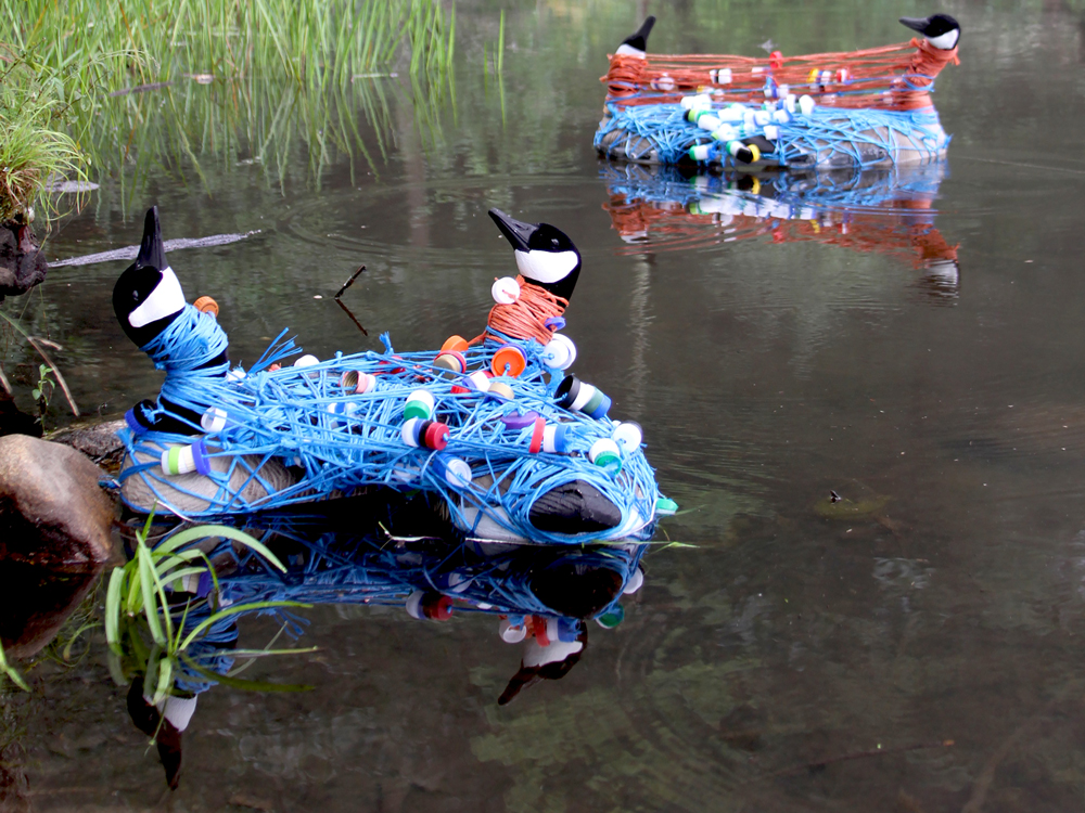 Duck Swan Goose sculpture on water