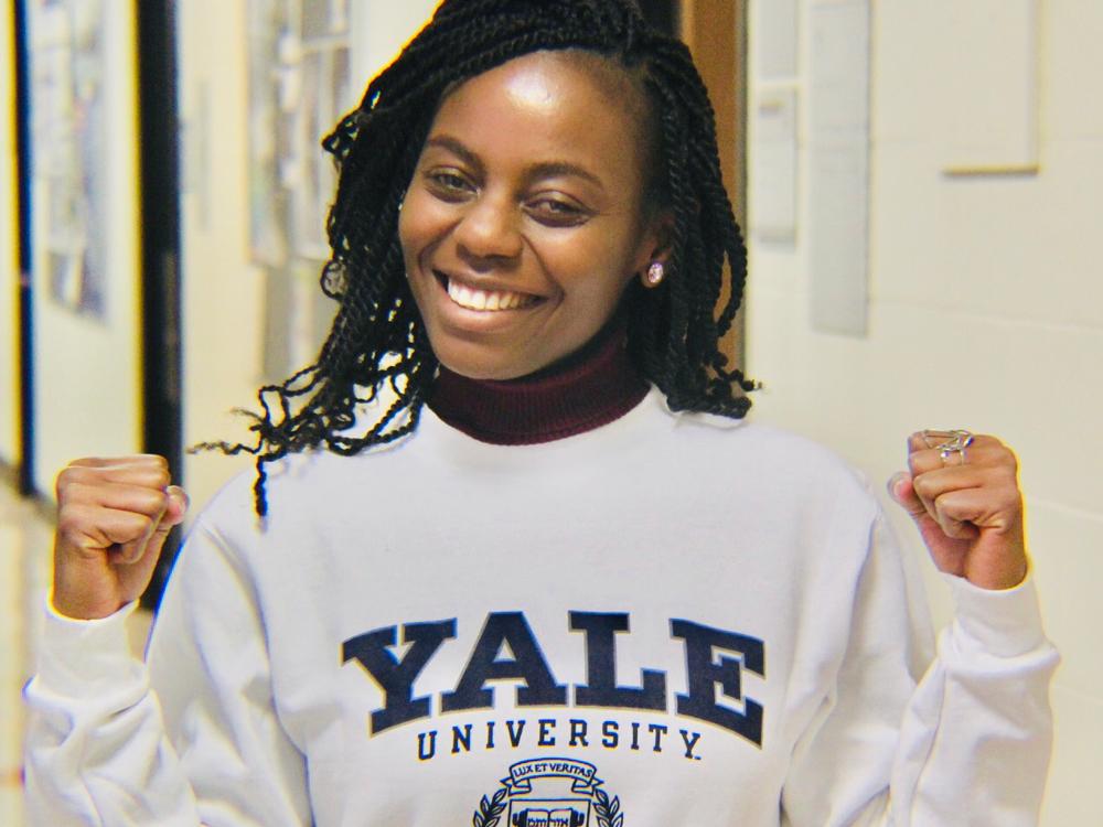 Ketty Munyenyembe smiling in a Yale sweatshirt
