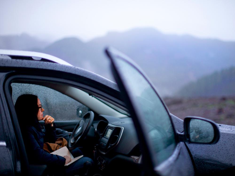Noelle Crombie in a car on Highway 20