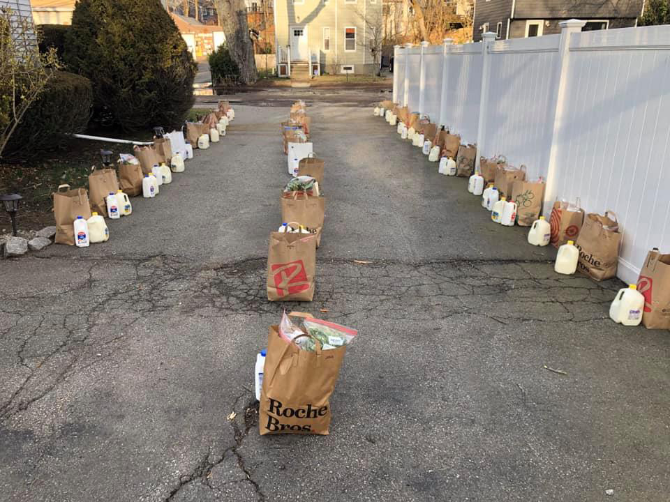 Paper grocery bags filled with food set several feet apart