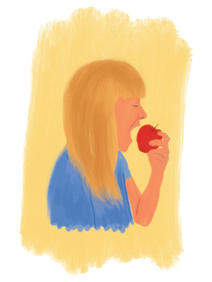 person with long blonde hair eating an apple