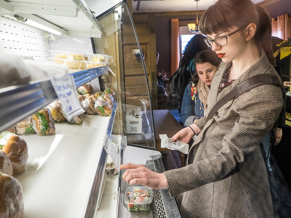 Students choosing food from a grab and go cold case