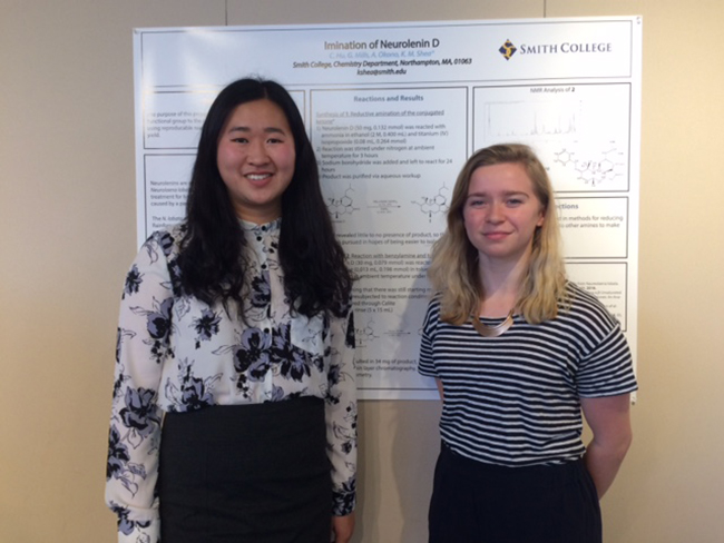 Cindy Hu '19 and Grace Mills '19 with the poster they created showing the results of their experiment with neurolenin D.