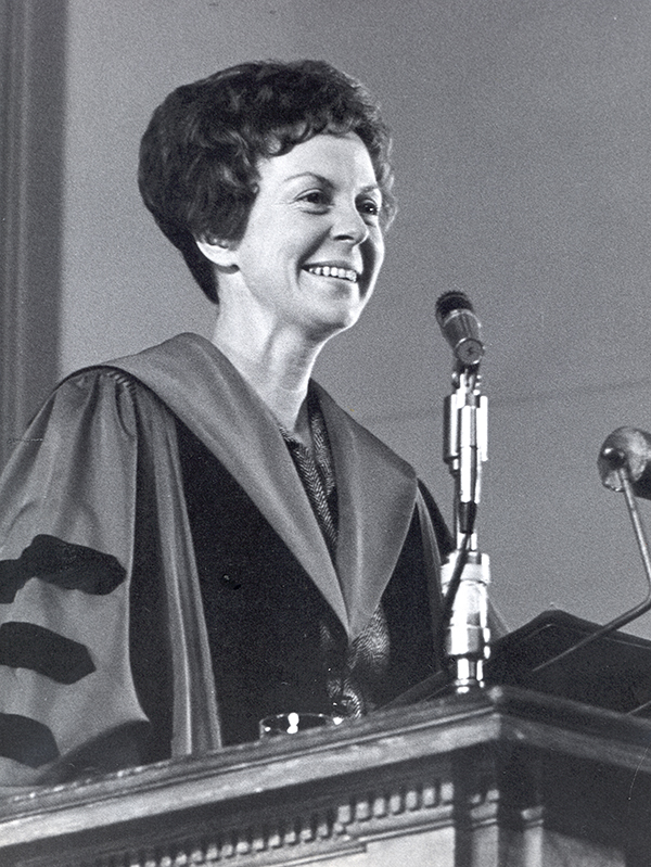 Jill Conway speaking at a podium