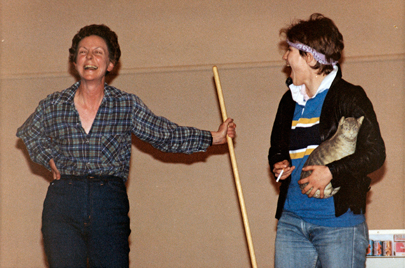 Jill Conway on stage with a student