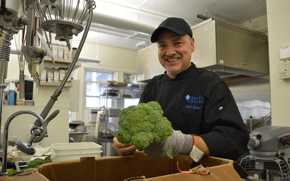 A chef prepares vegetables in the kitchen