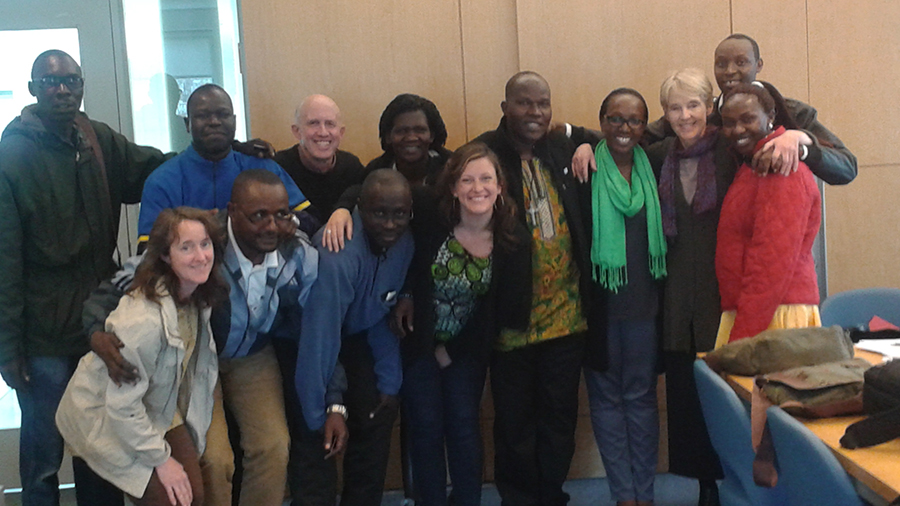 Smith School for Social Work Professor Josh Miller (3rd from left, back row) poses with community leaders from Africa and program administrators during a training on campus.
