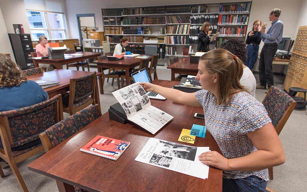 Students working with Smith special collections materials on tables in Young Library