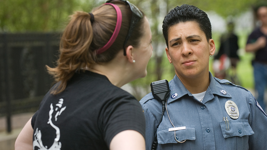 Campus police officer talking to a student