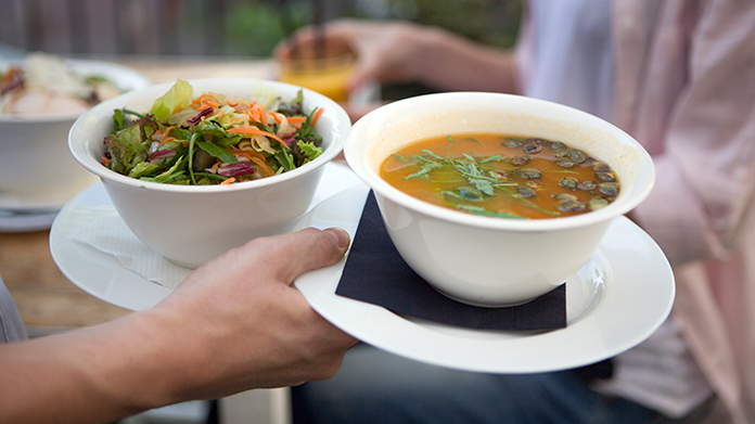 Soup and Salad being carried in bowls