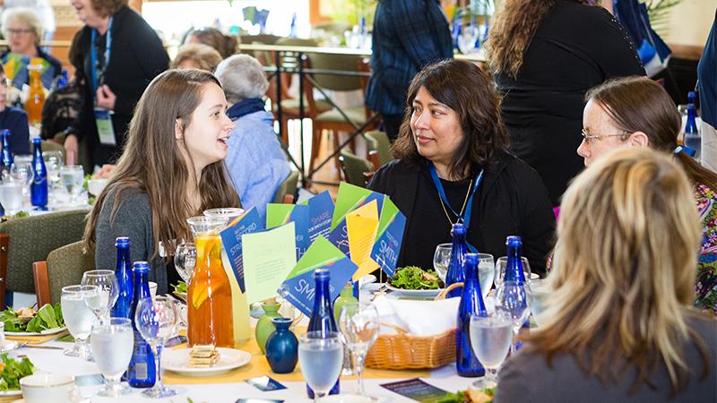 Alumnae volunteers sitting around a table