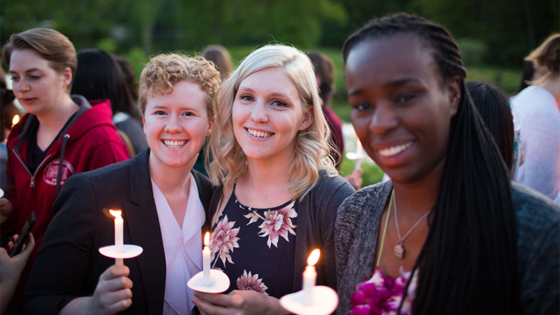 Photo of three students during Illumination