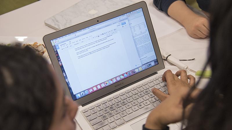 Students looking at a computer screen