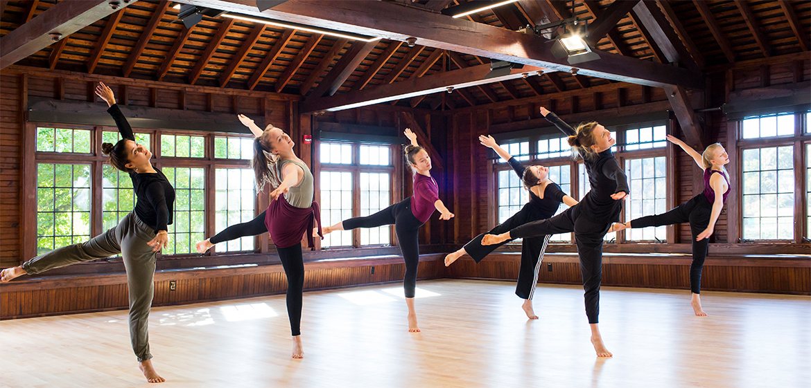 Six dancers rehearse in the dance studio