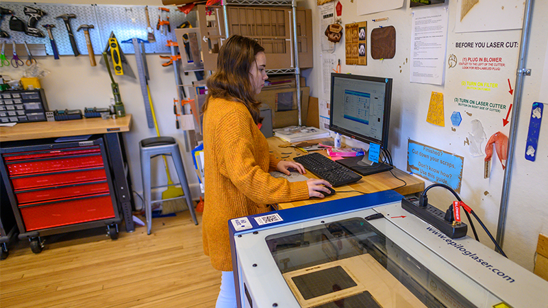 Smith student using the lasercutter