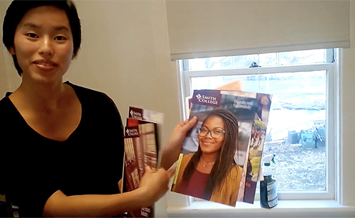 Student holding an admissions brochure