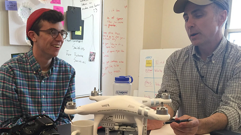Jon, the client, showing Matt some features of the drone