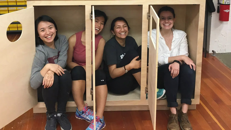 Four students smiling in the studio