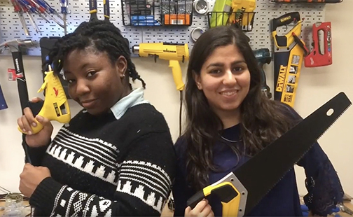 Students posing with tools