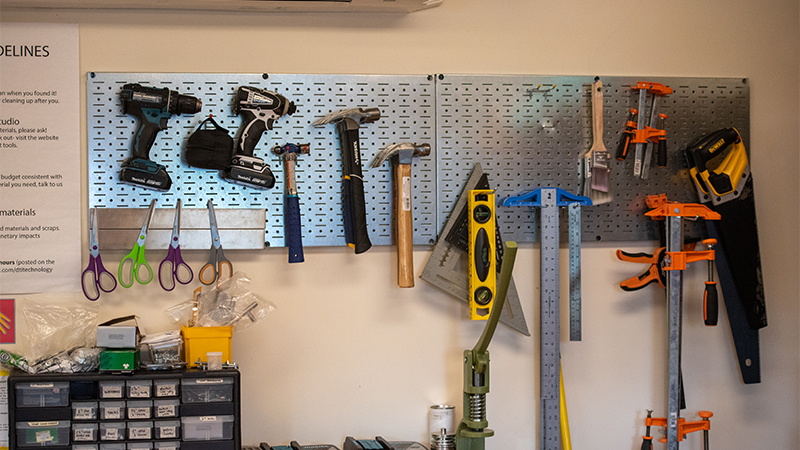 Various hand tools hanging on the wall
