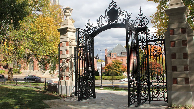 Open College Hall gates in the fall