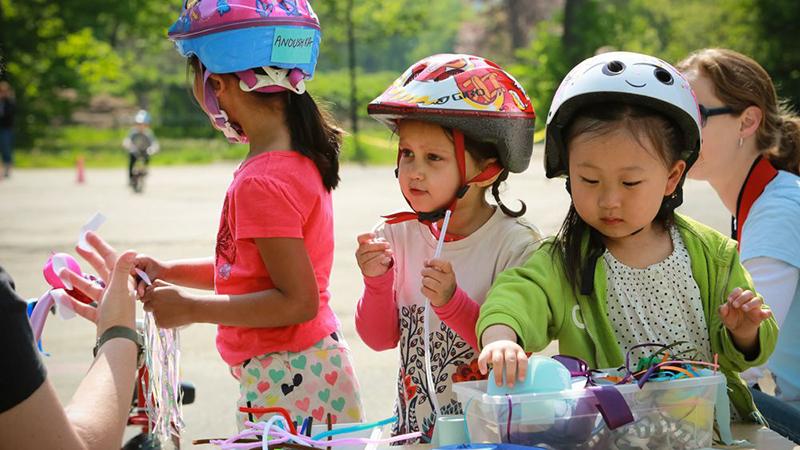 Three girls in bike helmets