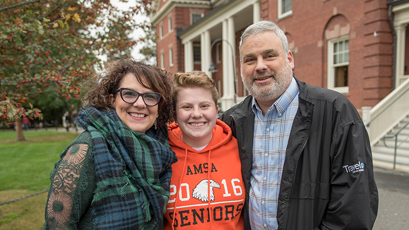 Student with her parents at Family Weekend