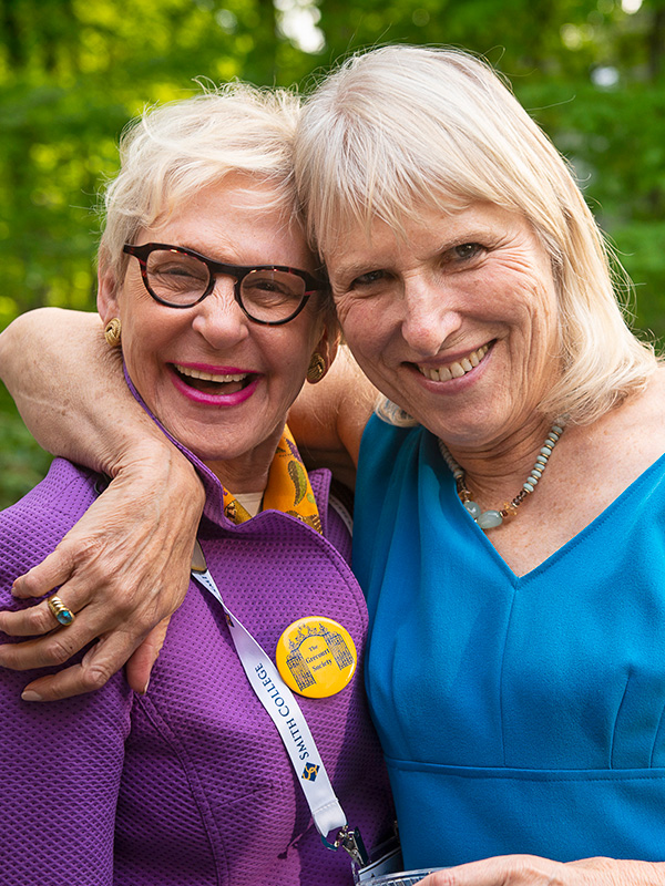 Two alumnae hugging at Reunion