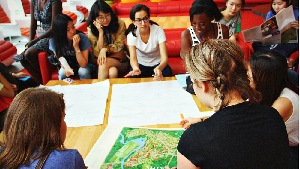 New Smith students gather around a campus map