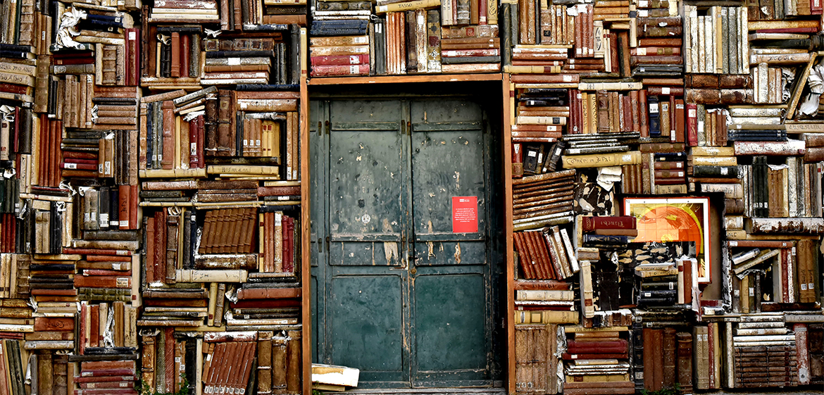 Italian doorway surrounded by stacks of books