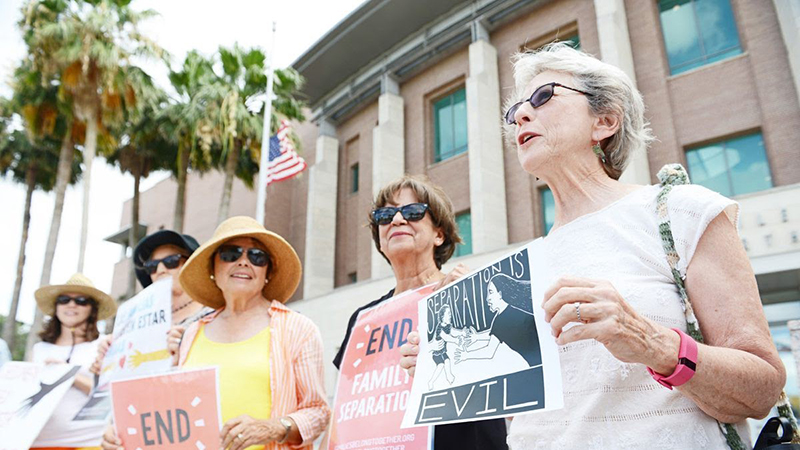 Group shot of four women protesters as part of The Angry Tias and Abuelas of the Rio Grande Valley