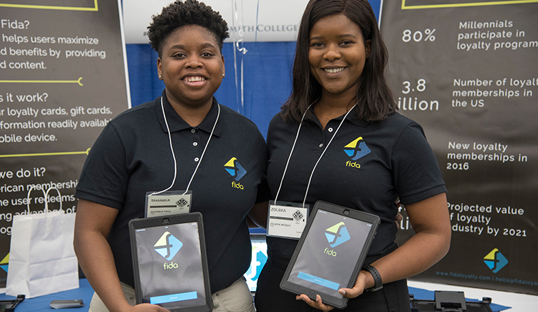 Two Fida employees at a booth at the Lazarus Center career fair