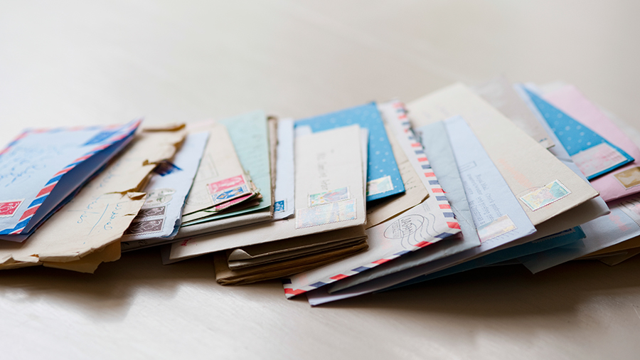 Assorted pieces of mail on a plain background