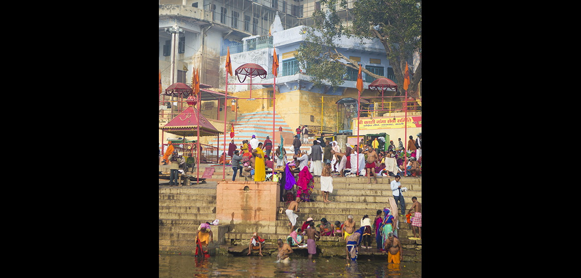 People alongside the Ganga River