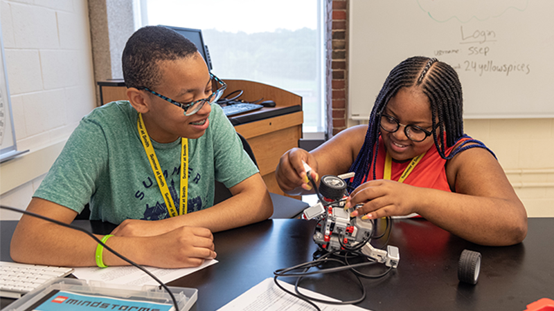 Two students working together in a robotics class
