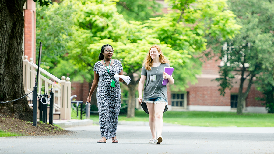 Two young women walk Smith College campus during summer programs