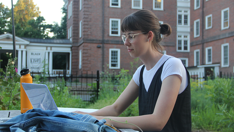 Image of Rachel Pietrow working on a laptop outside