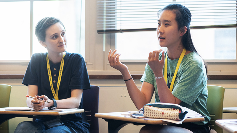 Students sitting in class, participating in the College Admission Workshop