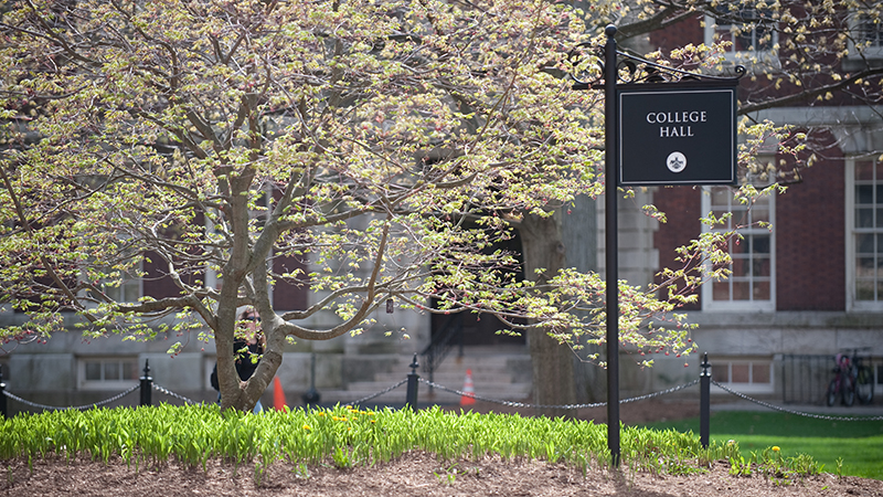 College Hall sign in spring