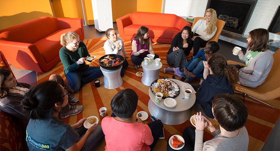 Group of students having tea and snacks