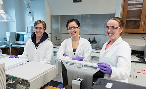 Three students in a lab in Ford Hall