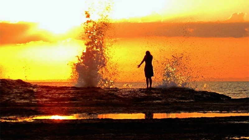 Photo of a student standing near the water in Costa Rica